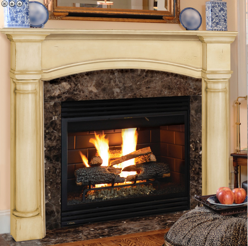 The Princeton wood mantel features wide round columns and an arched top opening and substantial columns