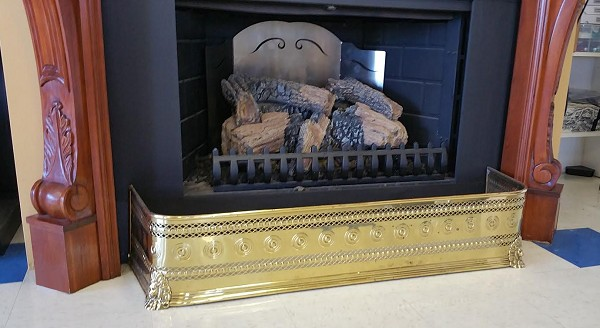 Pierced brass fireplace fender, antique